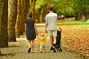 a family going for a walk with baby and stroller